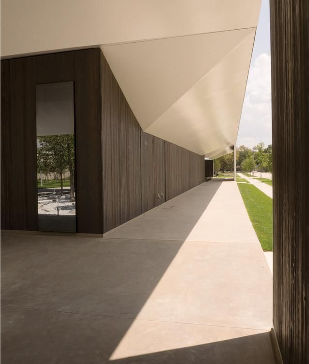 OPENING ANGLE Steel canopies shield the interiors of the Menil Drawing Institute from the Houston sun.