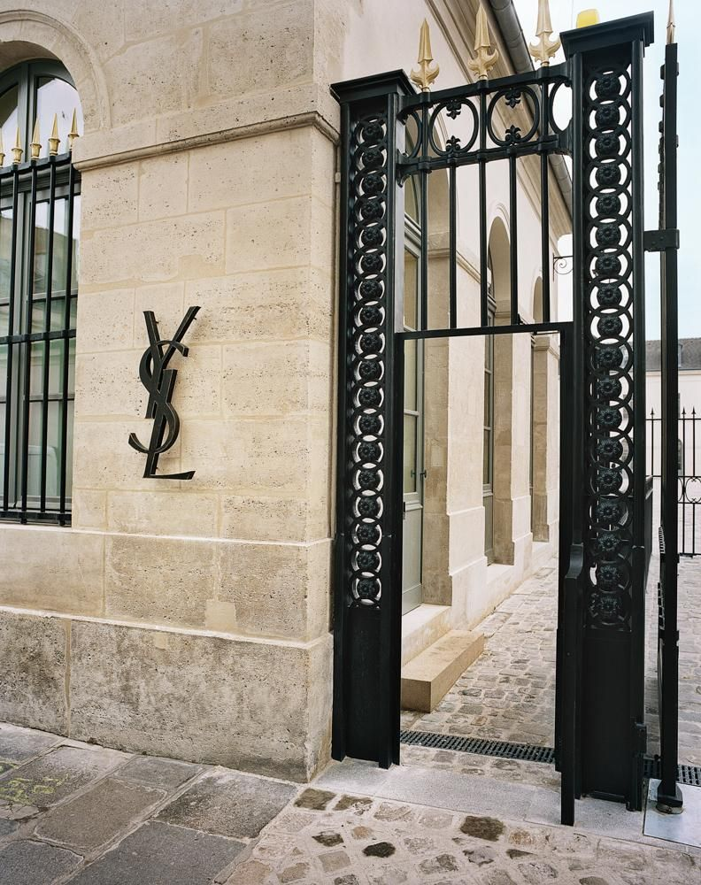 An entrance, featuring the original logo as commissioned by Yves Saint Laurent.
